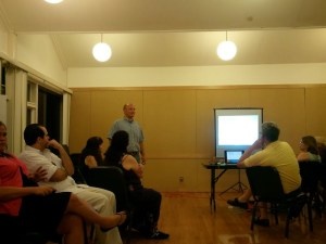 Andy Maskell presents his idea for to a group of artists and friends.